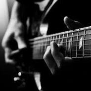 Image of a guitarist playing a guitar